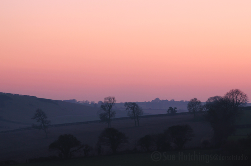 Piddle Hinton at sunset by Sue HUtchings